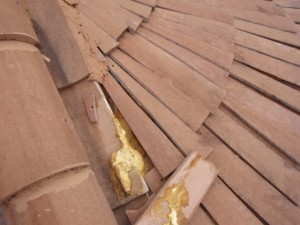 Loose tapered tiles at top of turret